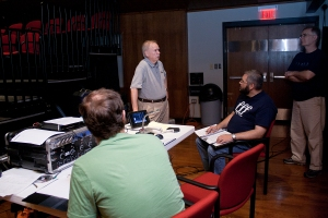 Kyle Hickey, Rich Mays, myself, and Stacy Rodgers listening and discussing in the control room. Photo by Sara Lowrey.