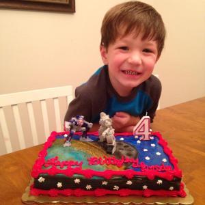 Brody Donald Haddon Everett, celebrating his fourth birthday with a Transformers-themed cake.